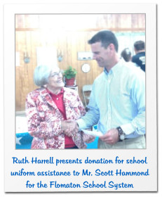 Ruth Harrell presents donation for school uniform assistance to Mr. Scott Hammond for the Flomaton School System