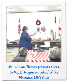 Mr. William Reaves presents check to Ms. JJ Hagan on behalf of the Flomaton LEO Club